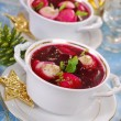 Red borscht with ravioli for christmas — Stock Photo #34807325