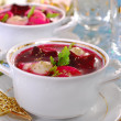 Red borscht with ravioli for christmas — Stock Photo #34807375