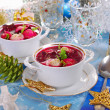 Red borscht with ravioli for christmas — Stock Photo #34807443