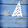 Christmas card with snowflakes and tree on blue wooden backgroun — Stock Photo