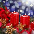 Christmas decoration with red candles — Stock Photo