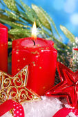 Christmas decoration with red candle — Stok fotoğraf