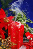 Christmas decoration with red candle with smoke — Foto Stock