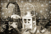 Christmas vintage lantern in snow at wooden background in sepia — Stok fotoğraf