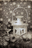 Christmas vintage lantern in snowy night in sepia — Stock Photo