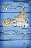 Christmas symbol shapes cut from music sheets on blue wooden bac — Stok fotoğraf