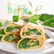 Rolled spinach pancakes as shashlik on sticks — Stock Photo