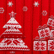 Christmas tree and gift shapes cut from knitted pattern — Stock Photo #36135413