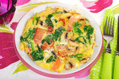 Spinach frittata with mushroom,ham and dried tomato — Stock Photo