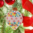 Homemade gingerbread cookie hanging on christmas tree — Stock Photo