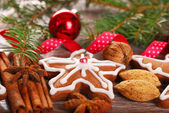 Christmas decoration with gingerbread cookie and spices — Stock Photo