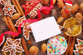 Christmas background with gingerbread cookies ,cutters and spice — Stock Photo