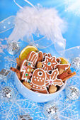 Bowl of homemade christmas gingerbread cookies on blue backgroun — Stock Photo