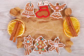 Christmas frame with gingerbread cookies and spices on old pape — Stock Photo