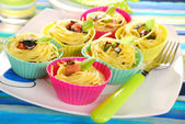 Pasta nests baked in silicone muffin molds — Stock Photo