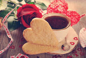 Coffee and heart shaped cookies for valentine in vintage style — Stok fotoğraf