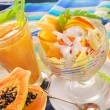 Fresh fruits smoothie and salad with papaya,banana,orange,pineap — Stock Photo