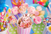 Birthday party table with marshmallow pops and other sweets for  — Stock Photo