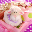Easter basket with eggs and sheep figurine — Stock Photo #41702115