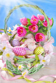 Easter basket with eggs ,sheep and fresh tulips — Stock Photo