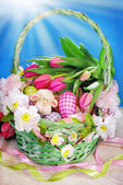 Easter basket on blue background  — Stock Photo