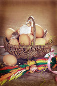 Rural braided basket with eggs and sheep for easter in vintage s — Stock Photo