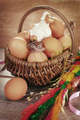 Rural braided basket with eggs and sheep for easter in vintage s — Стоковое фото
