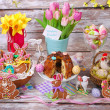 Easter table decoration with gingerbread cookies and ring cake — Stock Photo #43066473