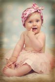Beautiful baby girl ,10 months in vintage style — Stock Photo