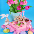Easter decoration with wooden bunny and fresh tulips — Stock Photo #44145553