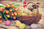Wicker basket with rooster and eggs for easter  — Foto de Stock