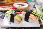 Nigiri sushi with salmon and avocado — Stock Photo
