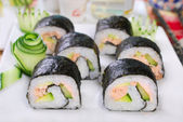 Maki sushi rolls with salmon and avocado — Stock Photo