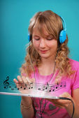Girl listening to the music on tablet — Stock Photo
