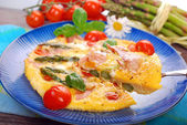 Frittata with green asparagus,ham and cherry tomato — Stock Photo