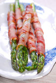 Grilled green asparagus wrapped in bacon — Stock Photo