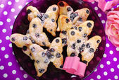 Puff pastry cookies with blueberry in butterfly shape — Stock Photo