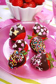 Chocolate covered fresh strawberries with colorful sprinkles — Stock Photo