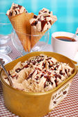 Coffee ice cream in plastic box and cones — Stock Photo