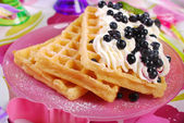 Waffles with whipped cream and blueberries — Stock Photo