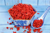 Dried goji berries on chinese spoon and in a bowl — Stock Photo