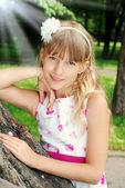 Portrait of beautiful young girl in a park  — Stock Photo
