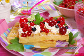 Waffles with whipped cream and fresh summer fruits — Stock Photo