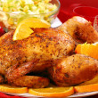 Roasted whole chicken with oranges — Stock Photo #5237378