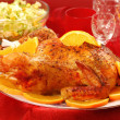 Roasted whole chicken with oranges — Stock Photo #5295328