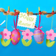 Easter border with hanging eggs — Stock Photo #9483687
