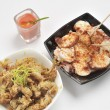 Tapas of Galician octopus and fried baby squid - Stock Photo