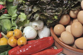 Table of raw vegetables and eggs — Stock Photo