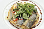 Sea bass fillets with salad canons — Stock Photo