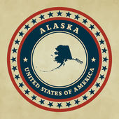 Vintage label with map of Alaska — Stock Vector